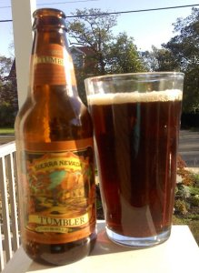 A bottle of Sierra Nevada Tumbler Autumn brown ale with a pint glass filled with Tumbler