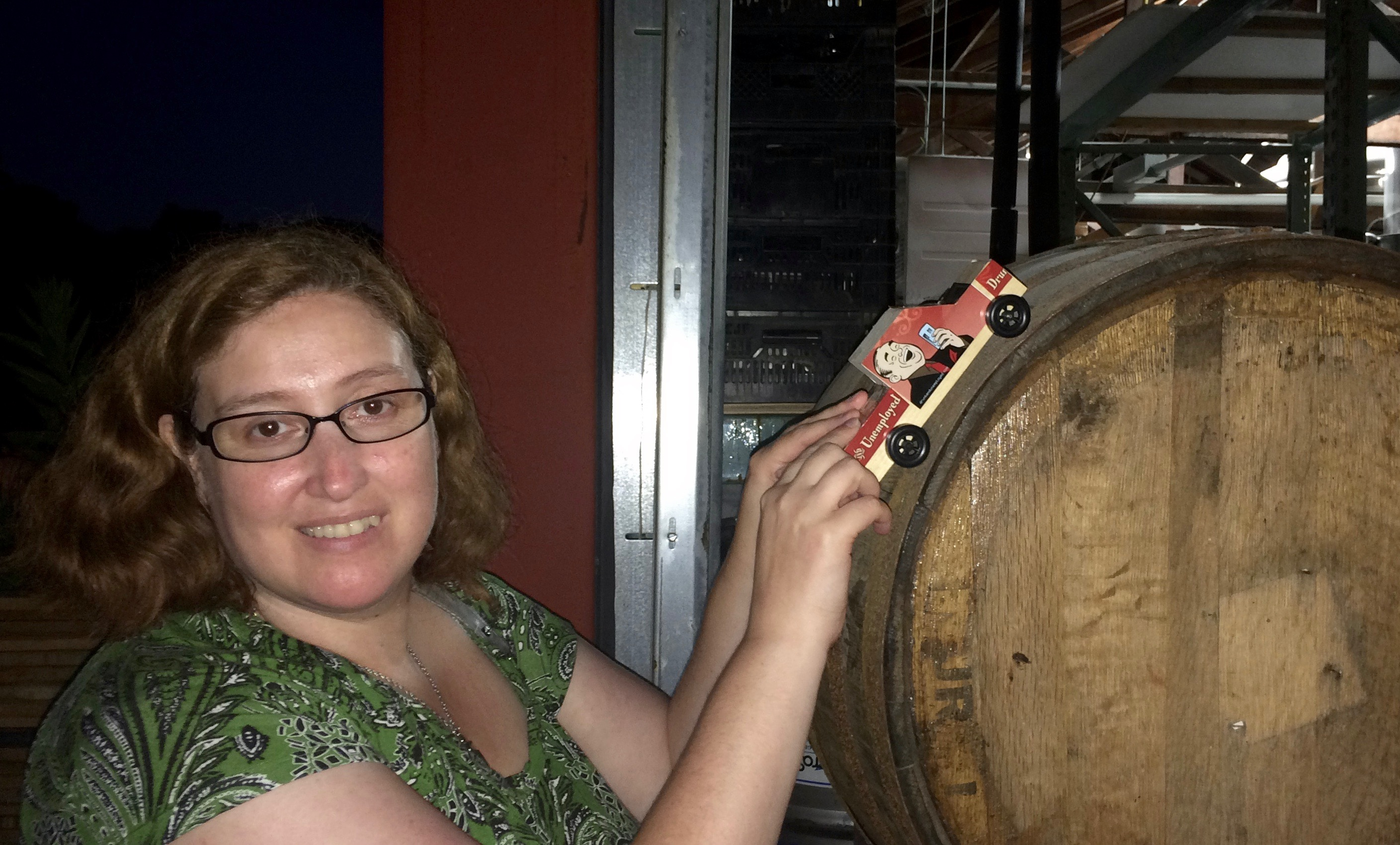 Drunk and Unemployed's writer and editor, Melba, rolls the DnU Generic Wheeler car over a barrel at Long Ireland Brewing.