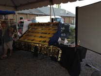 A large, yellow pinewood-car case holds up to 100 cars, waiting to race at Long Ireland Brewing's Pintwood Derby