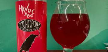 A can of Havoc Mead Psychopomp and a flared tulip glass partially filled with mead