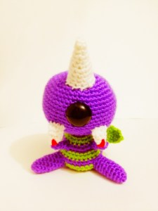 Crocheted flying purple people eater