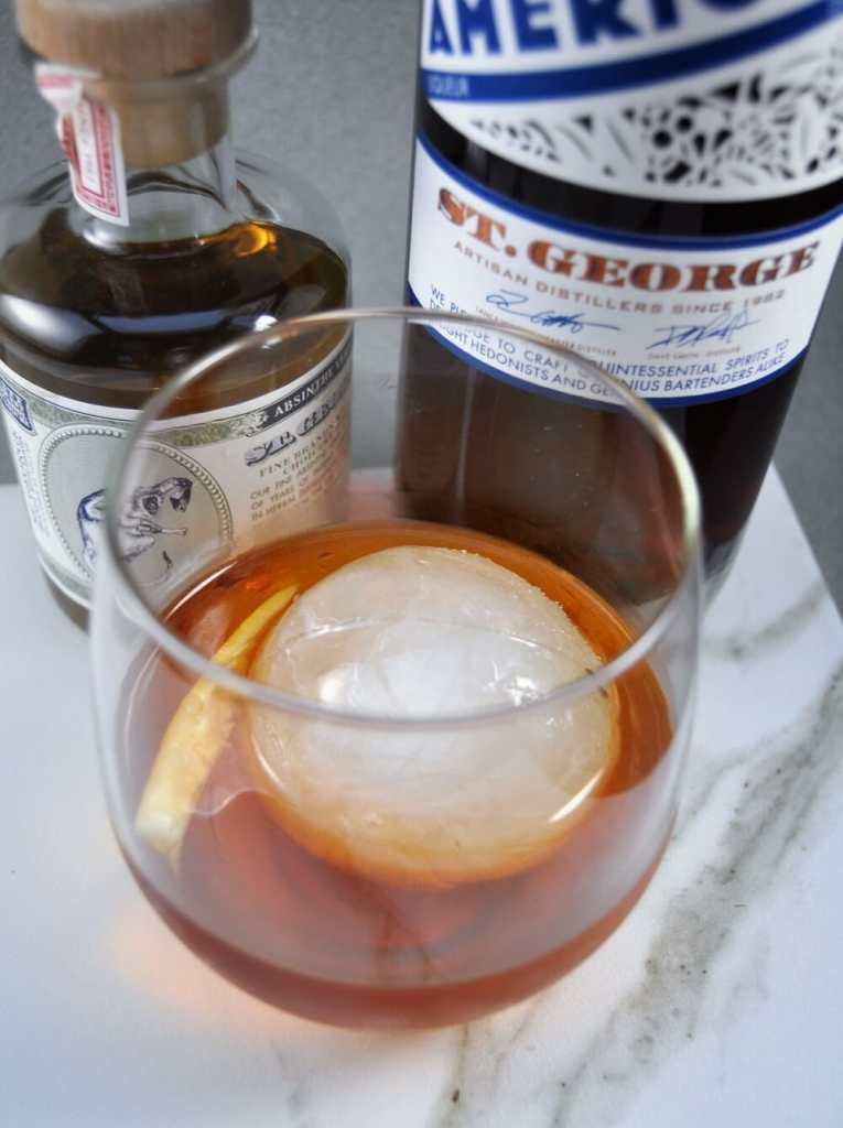 Cocktail next to 2 bottles