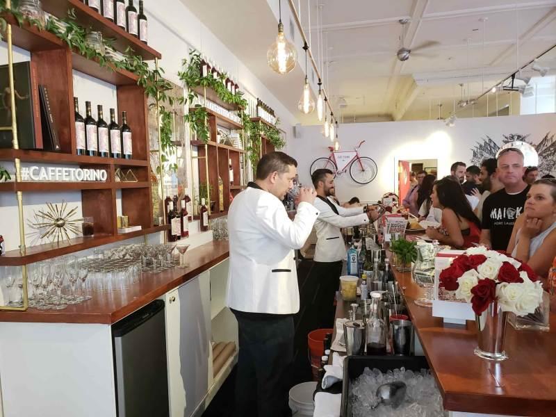 Men in suit jackets making cocktails