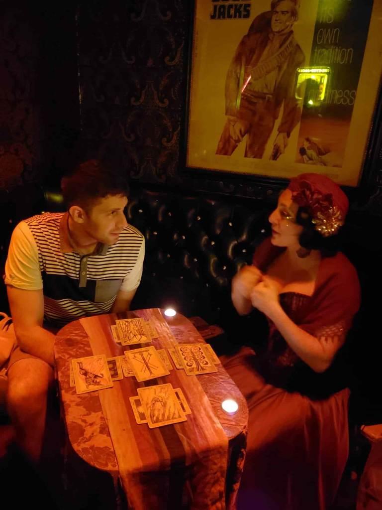 Woman and man with tarot cards