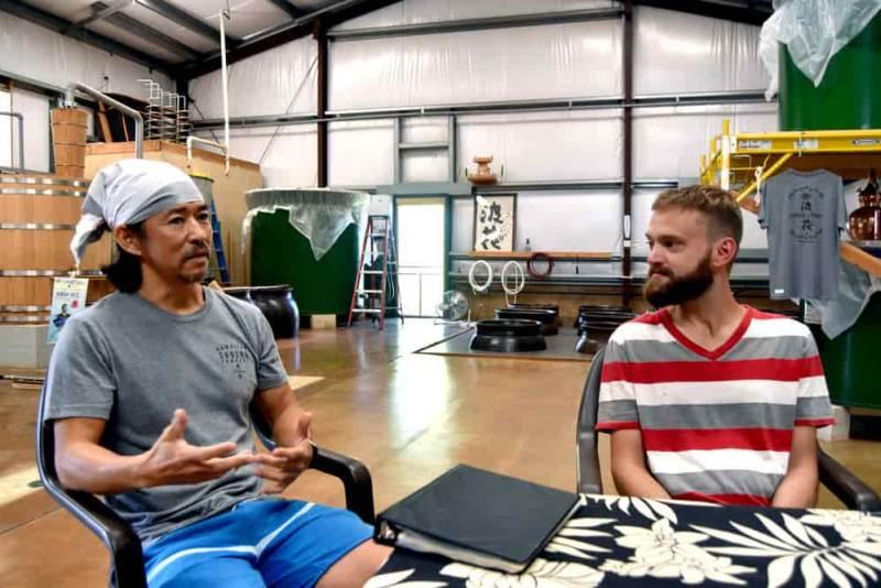 Two men talking in distillery
