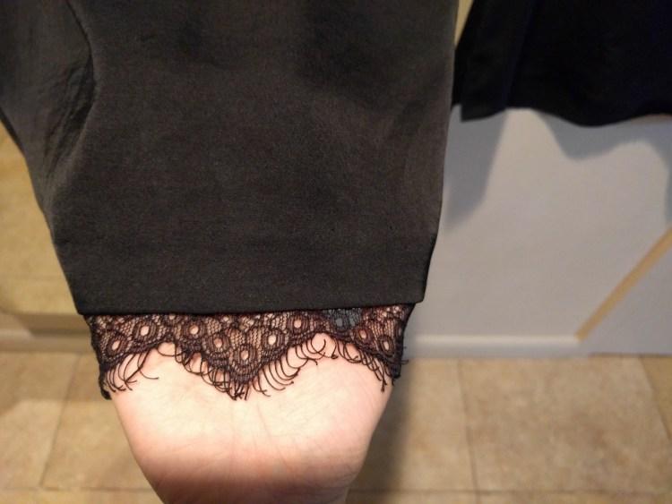 lace detailing on replaced black blouse