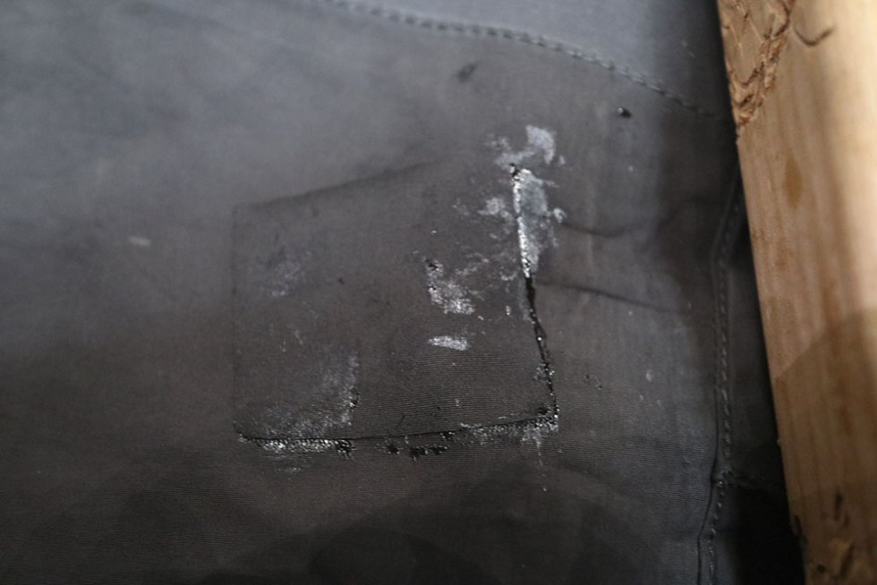 applying patch to breathable fishing waders