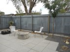 the back patio...durable corrugated fencing, place to sit