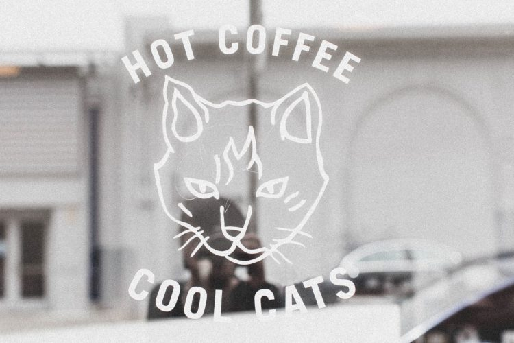 "Shop logo with cat and text reading ""Hot Coffee, Cool Cats"""