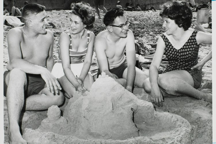 Boston College students on the beach