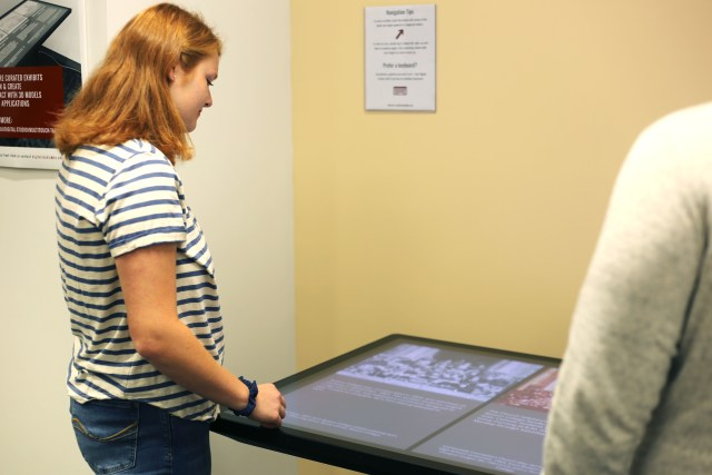 Image of student using the multitouch table