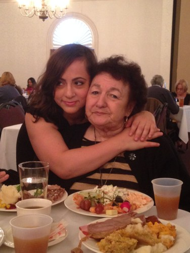My grandmother and sister Josie hug at the table.