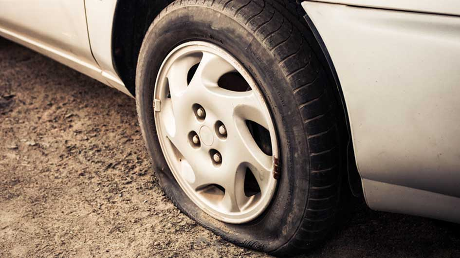 The picture shows a flat car tyre. Tyres shouldn't go on diet. Keep them full at all times.