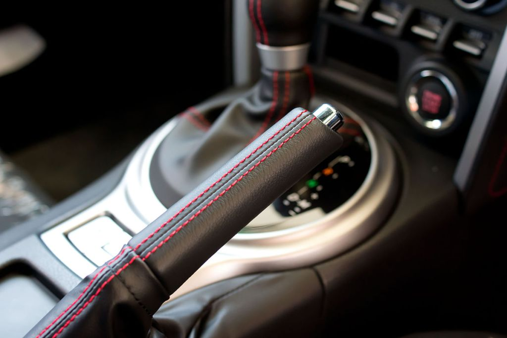 Handbrake lever are found between the driver and front passenger's seat.