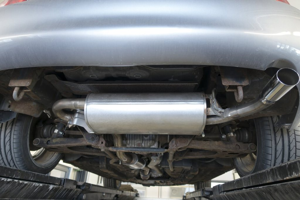 This shows the underhood of a car, exposing the car exhaust system.