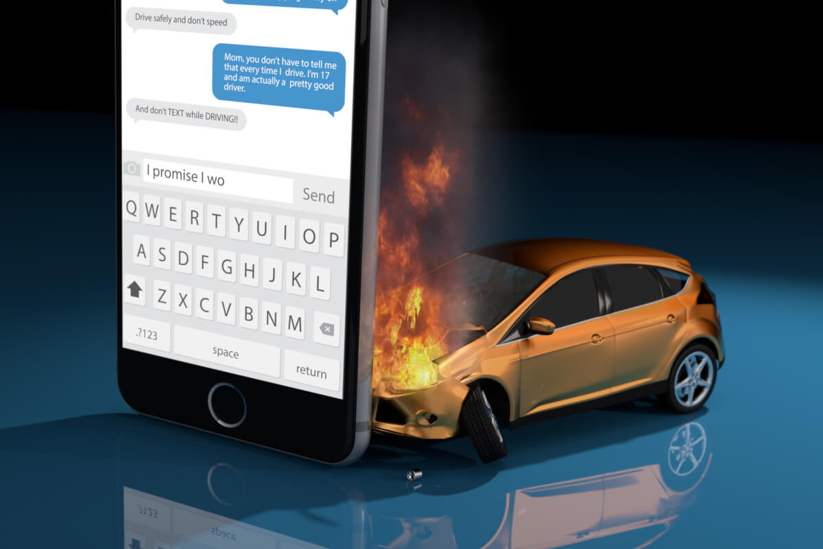 A car crashed into a smartphone, implying that we should not text and drive.