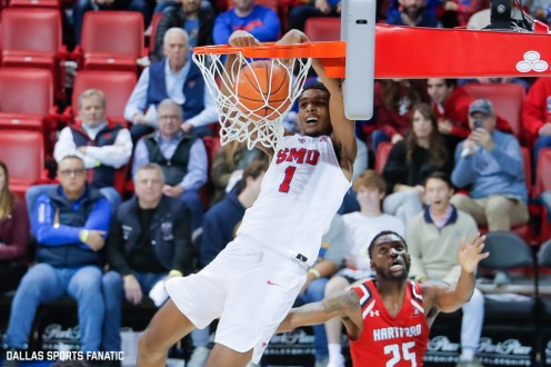 SMU forward Feron Hunt puts away an alley-oop during the second half of the game against Hartford on November 27, 2019 at Moody Coliseum in Dallas, Tx. (Photo by Joseph Barringhaus/Dallas Sports Fanatic)