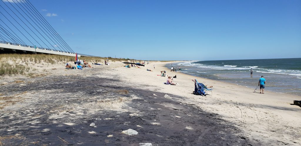 Indian River Inlet, north side beach, surfing beach, charles w cullen bridge, inlet bridge, coast guard station tower base, beach erosion, sand relocation pipe,
