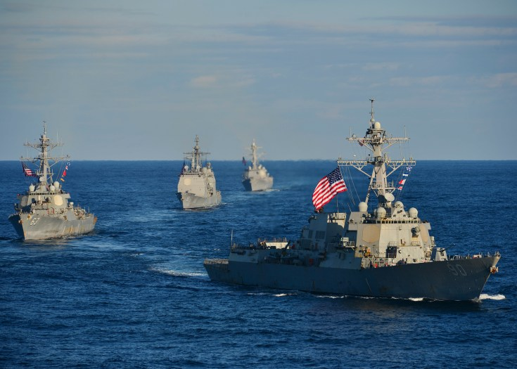 navy ships form a line in the pacific ocean