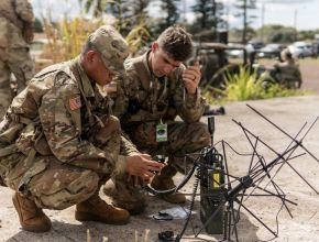 u.s. army soldiers work with a satellite ground station