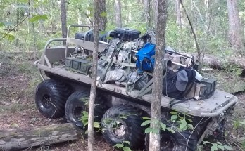eight wheeled robotic vehicle driving through the woods