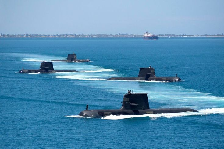 four submarines conducting group operations in blue water