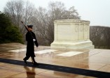 A Guard of Honor stands watch of the Tomb of the Unknowns.
