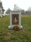 A memorial stands in the cemetery for those who were lost in the explosion of the Space Shuttle Challenger.