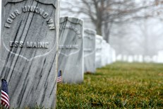Thousands of white granite headstones lie in rows, many of which mark the burial sites of unknown soldiers.