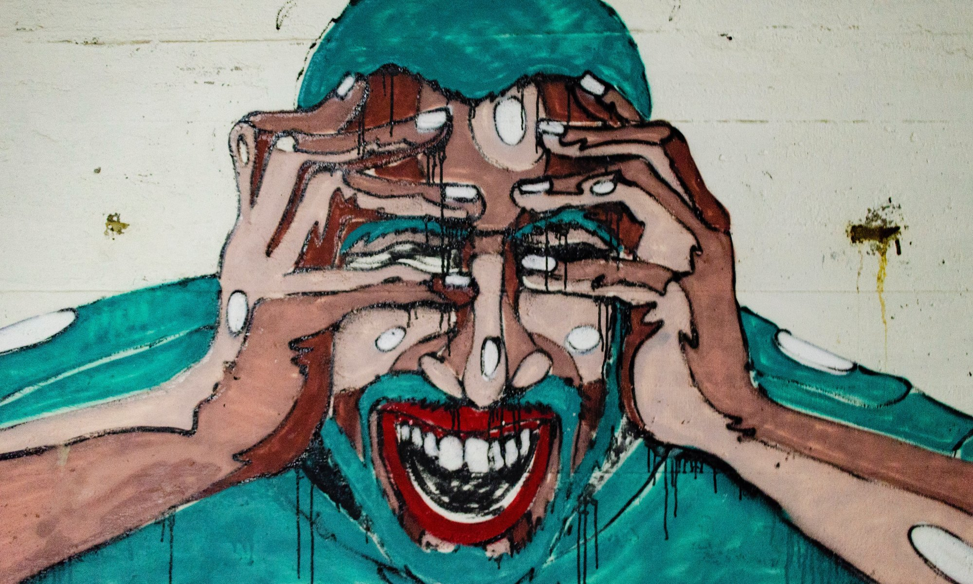 Graffiti of a stressed African American man with hands on his face