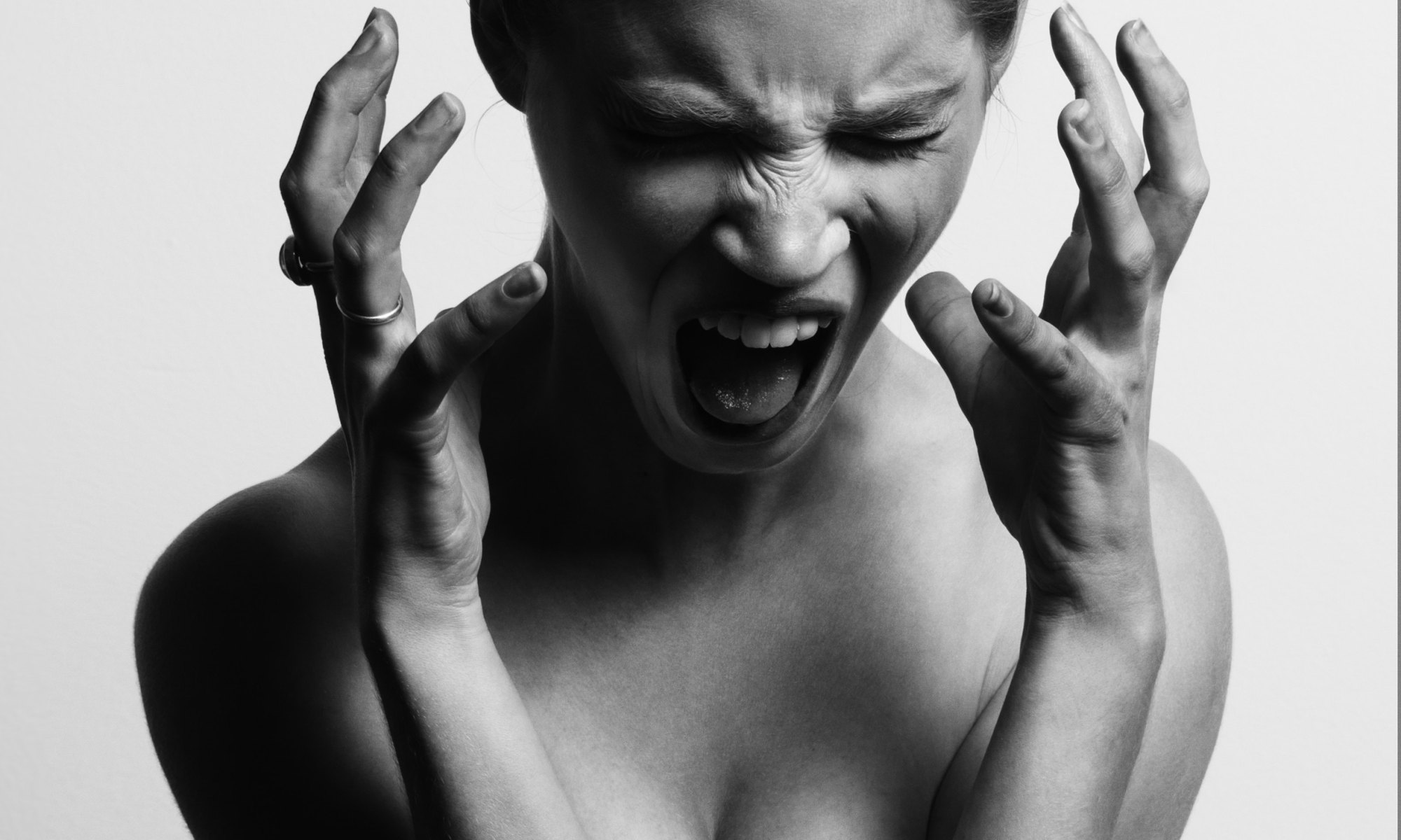 Naked woman yelling and feeling stressed