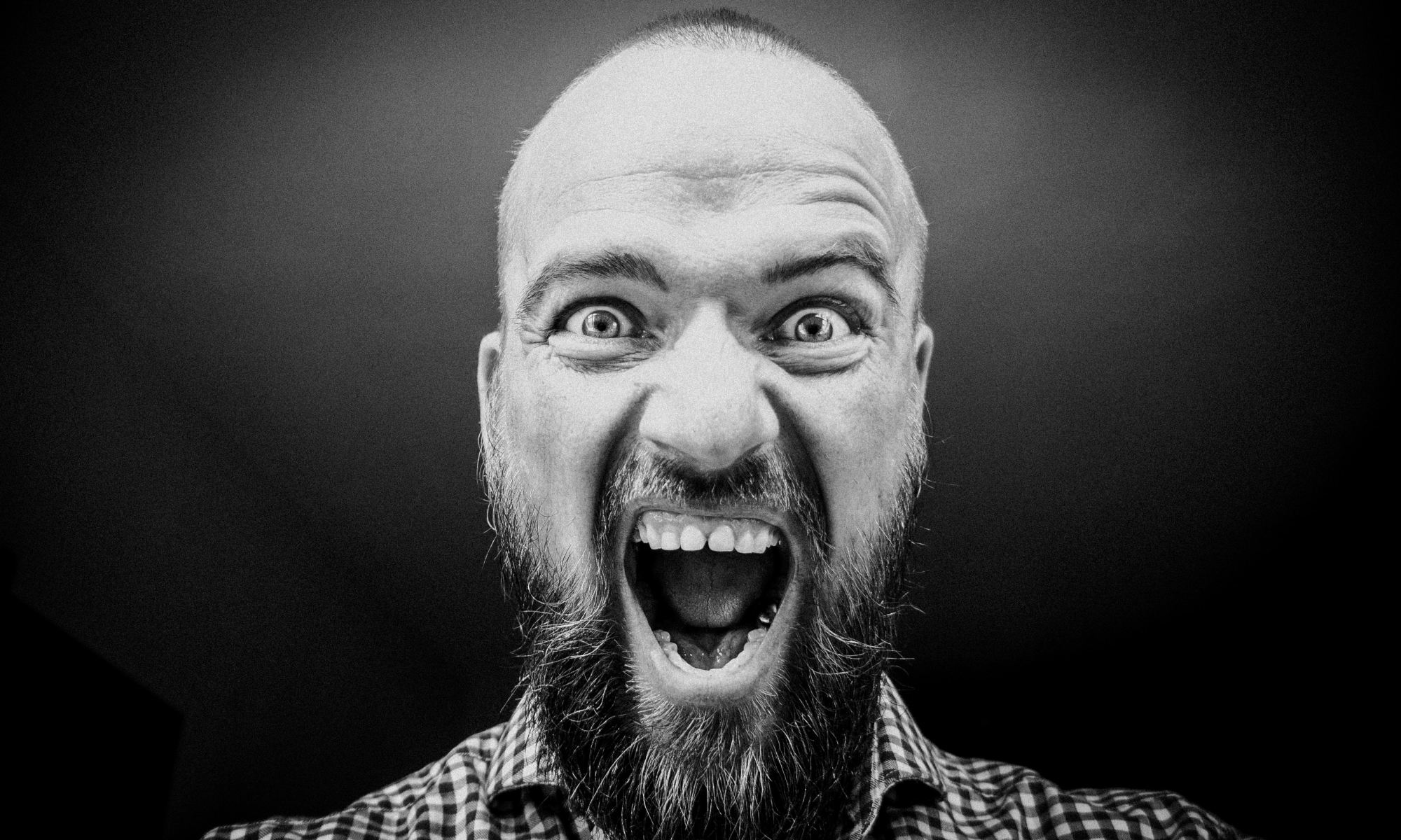 Grayscale photography of man experiencing brief psychotic disorder
