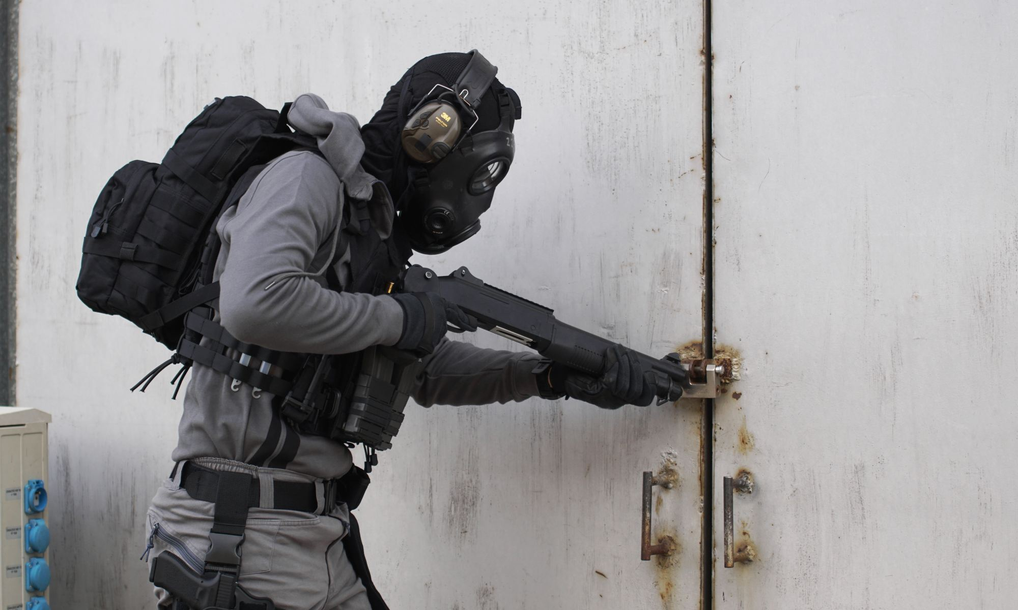 Mentally ill person wearing armor suit and carrying shotgun
