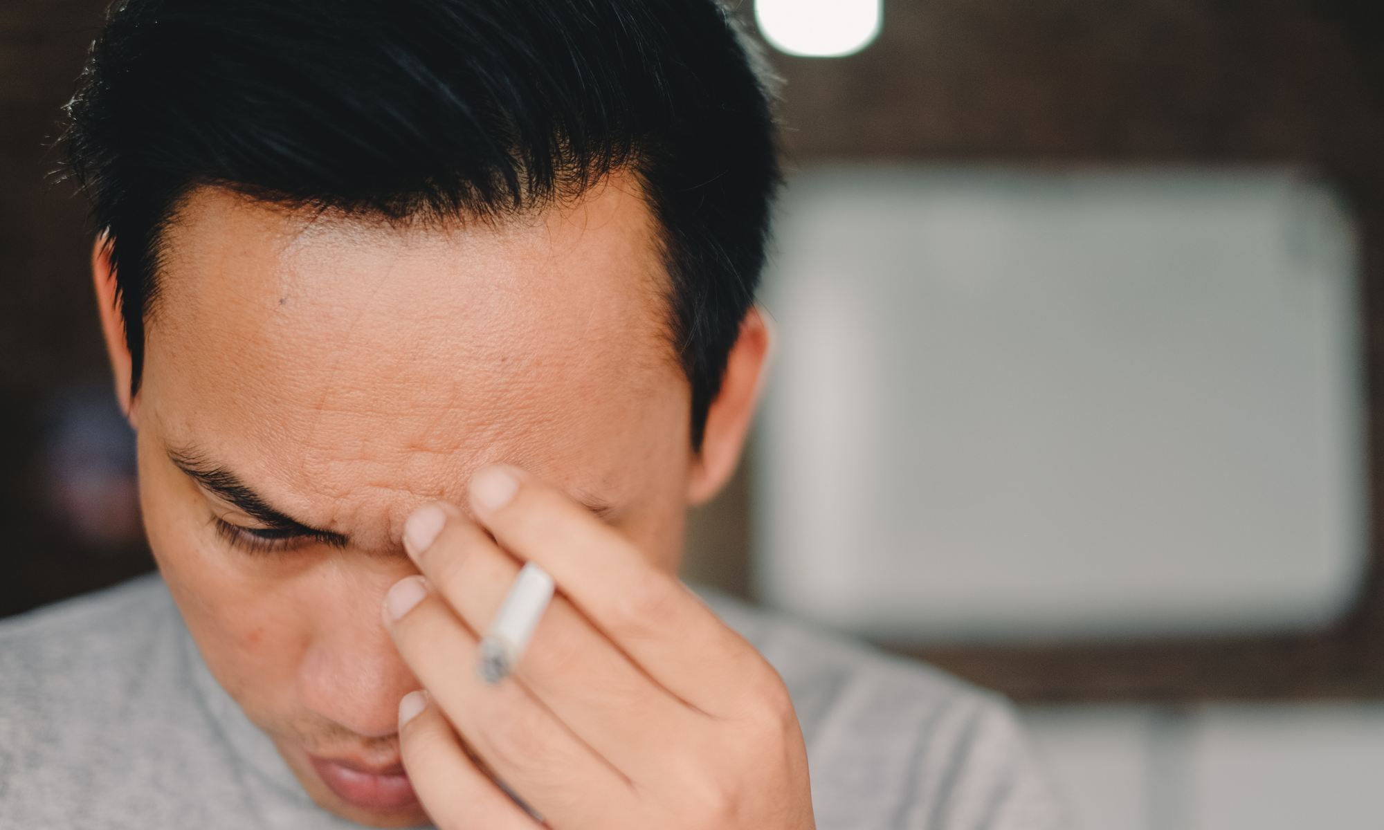 Man holding cigarette and worrying too much