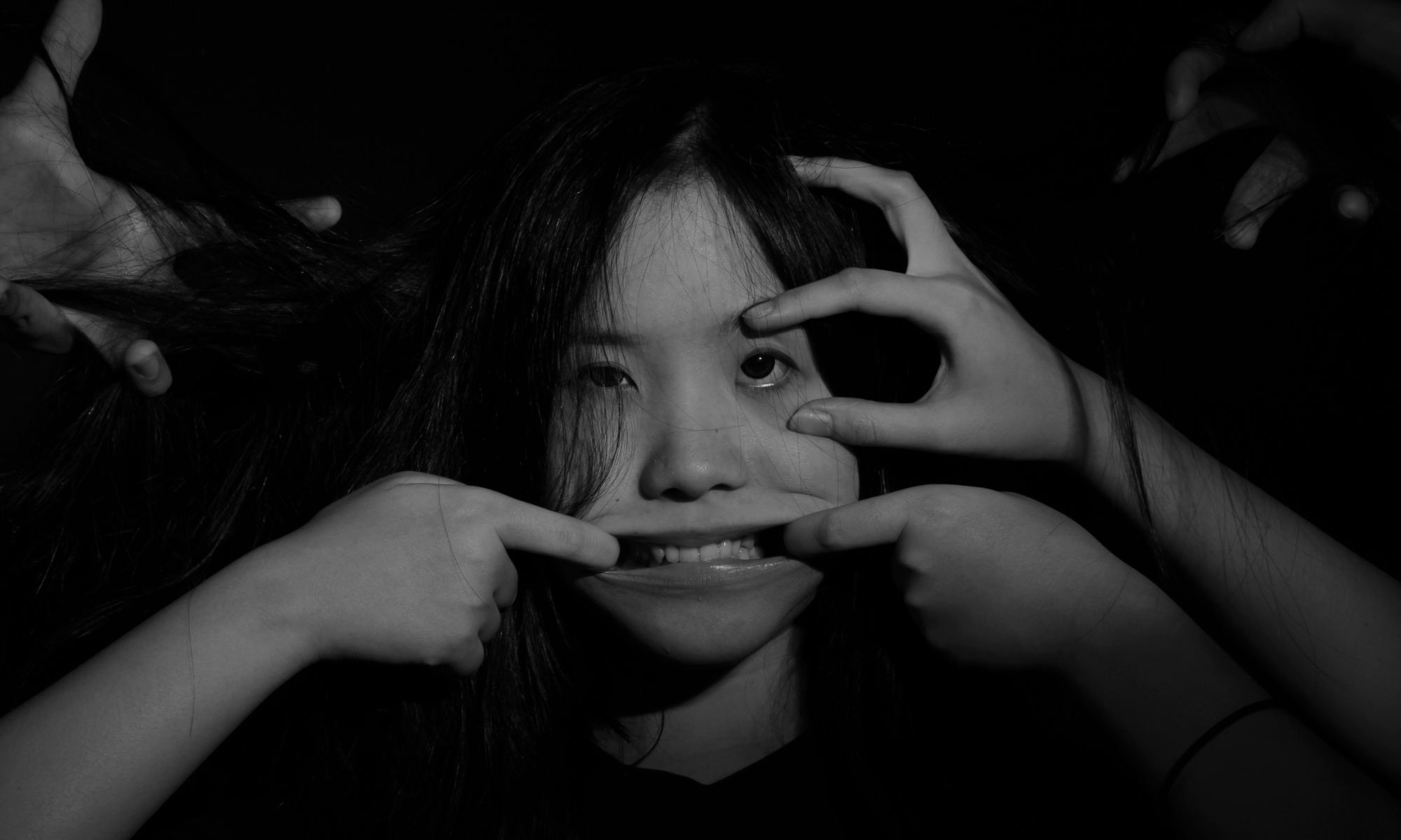 Grayscale photography of insecure asian woman