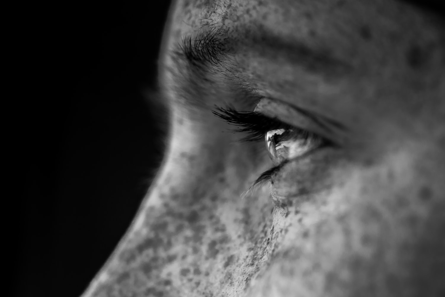 Grayscale photo of motivated person's face after waking up early