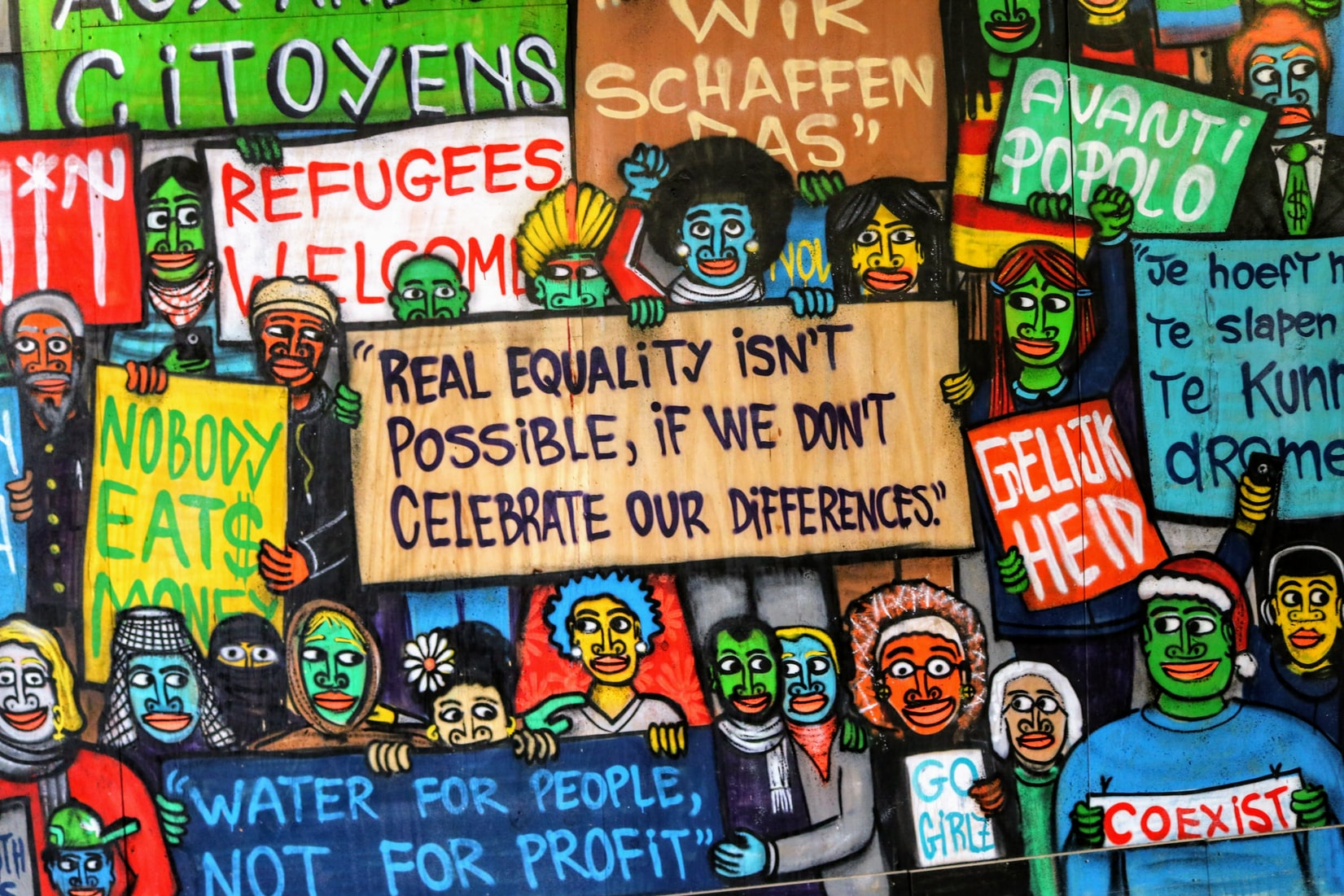 Colorful painting of cartoon figures holding different quotes related to racism and equality
