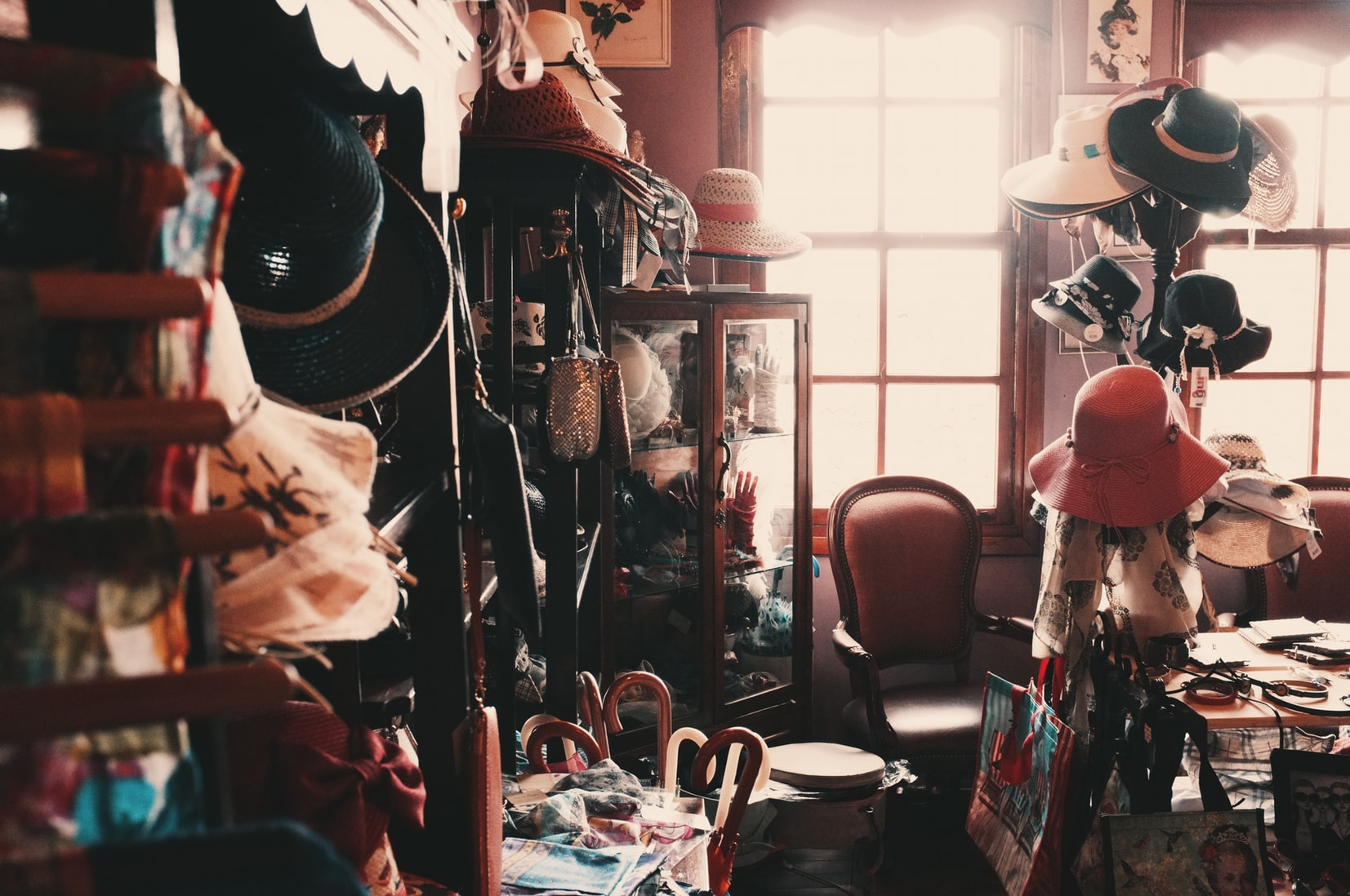 Room full of excessive hoarding of hats and other items