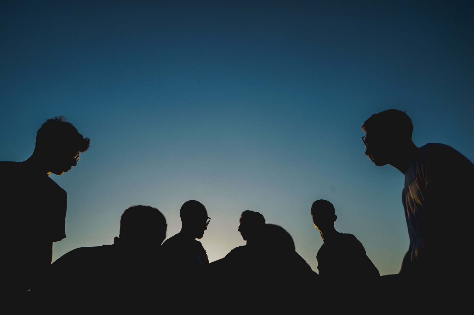 Silhouette photo of group of young people