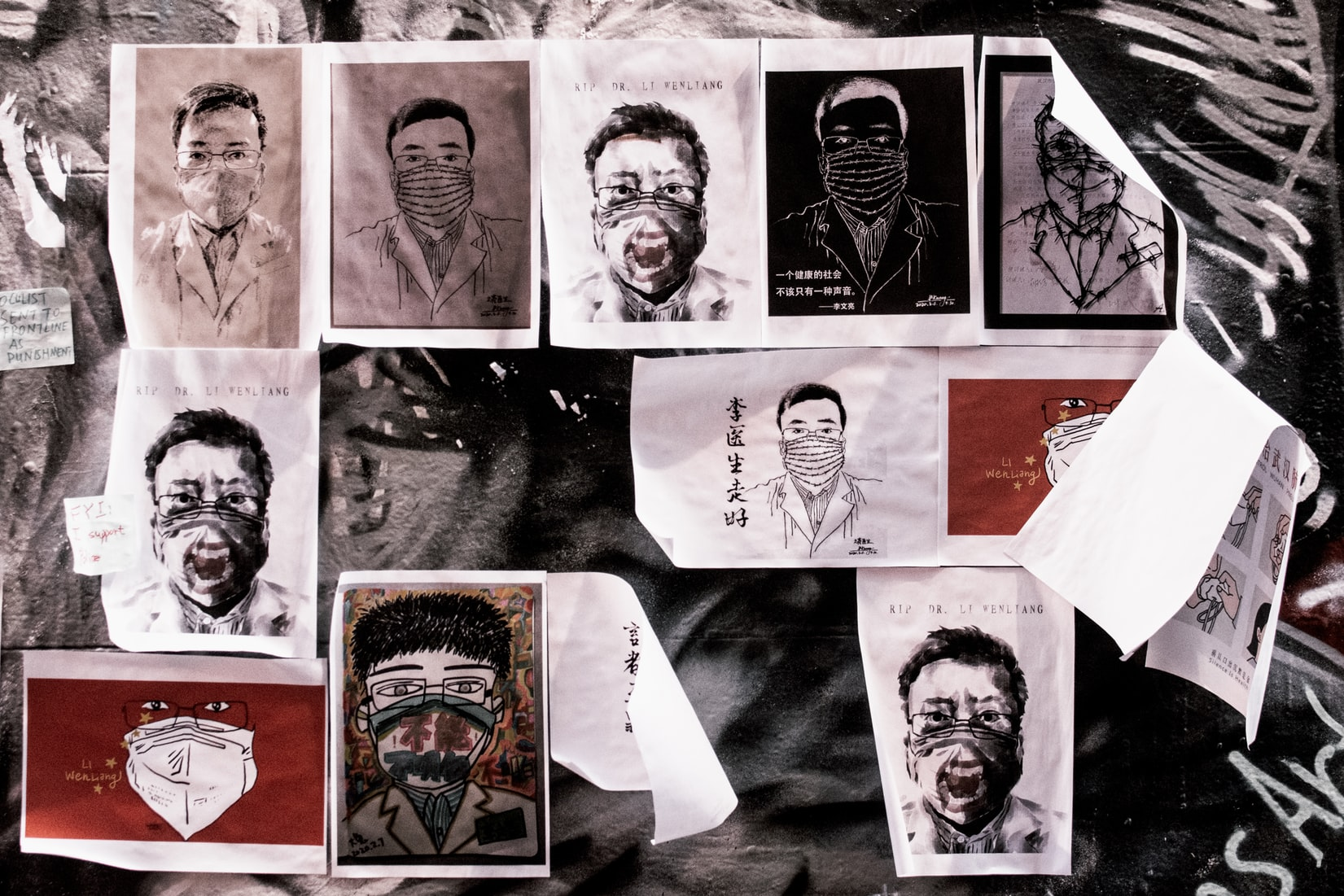 Drawings of Chinese man with face mask on wall