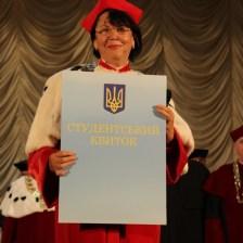 Rector Professor Nadiya Skotna presents a symbolic student card