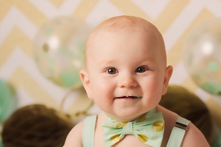 1st birthday cake smash glasgow - baby boy smiling