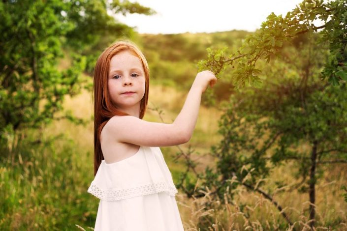 Family Photographer Glasgow - girl picking bush