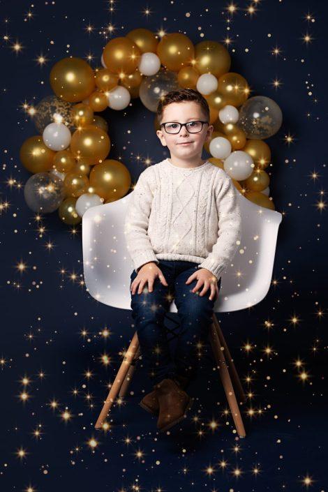 Family Photographer Renfrewshire - boy sitting in white seat