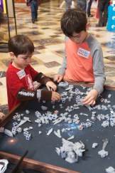 Two boys arranging plastic pieces