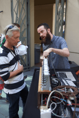 Two men looking at a fork organ