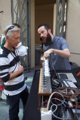 Two men looking at a fork organ