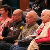 Elderly people watching a performance