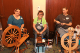 3 women with spinning wheels
