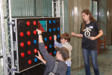 children playing on a giant circuit board